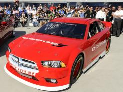 The NASCAR model of the 2013 Dodge Charger was unveiled March 11 at Las Vegas Motor Speedway, 10 days after Penske Racing announced it would leave for Ford in 2013.