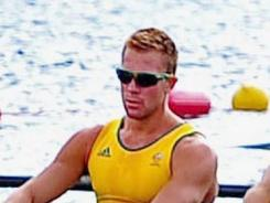 Australia's Joshua Booth was detained by police early Thursday morning in London for causing damage to a storefront in an alcohol-related incident hours after he competed in the men's eight at the Olympics.