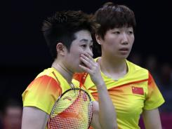 China's Yu Yang, left, was one of eight players disqualified from the badminton doubles tournament for trying to lose games in order to gain a more favorable position in the next round of competition.