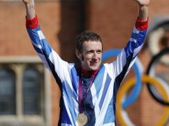 Cyclist Bradley Wiggins' celebration after winning a gold medal in the men's individual time trial went beyond the podium.