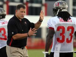 Tampa Bay Buccaneers head coach Greg Schiano talks with running back Robert Hughes (33) during training camp at One Buc Place on July 28, 2012.