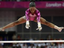 Gabby Douglas competes on the uneven bars in the women's individual all-around final Thursday at the 2012 London Olympic Games.