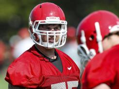 Georgia offensive tackle Kolton Houston (75) stands on the field during practice on Thursday.