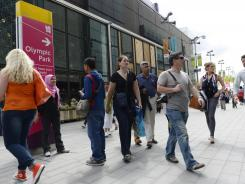 Shoppers walk in an exterior area of Westfield Mall next to Olympic Park.