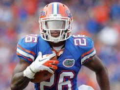 Gators safety De'Ante Saunders with an interception last season.