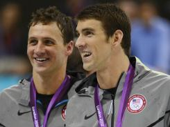 Michael Phelps, right, won his 20th career Olympic medal in the 200-meter IM, while Ryan Lochte won his 11th.