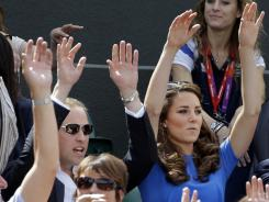 Prince William and Kate, Duchess of Cambridge, join the crowd in doing the wave Thursday at a tennis match between Andy Murray of Britain and Nicolas Almagro of Spain at the All England Club.