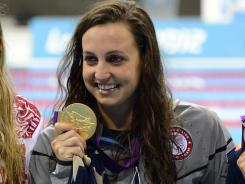 \Rebecca Soni shows off her gold medal after the women's 200m breaststroke final.