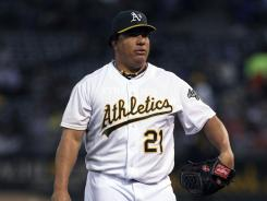 Oakland's starting pitcher Bartolo Colon returned to the dugout after pitching eight shutout innings against the Toronto Blue Jays at O.co Coliseum.