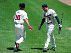 Atlanta's Chipper Jones and Freddie Freeman each hit two-run doubles in a 6-1 victory over Miami.