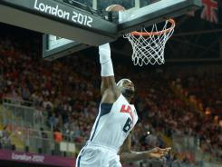 LeBron James throws down an emphatic dunk during the first half of the USA's game vs. Nigeria.