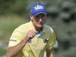 Jim Furyk reacts after making a birdie on the eighth hole during the first round Thursday of the WGC-Bridgestone Invitational at Firestone Country Club in Akron, Ohio. Furyk leads by two shots.