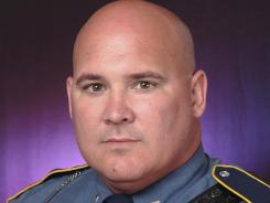 Arkansas State Police Cpl. Royce Denney, who found a gun and marijuana during a traffic stop of then-Arkansas State running back Michael Dyer, has been fired from the agency.