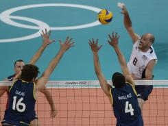 William Priddy, spiking the ball against Brazil's Wallace (4) and Lucas (16), recorded 17 points, including match point, to lift the U.S. to a 3-1 win.