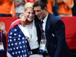 Shared victory: Kayla Harrison celebrates with coach Jimmy Pedro, a four-time Olympian in judo who won bronze in 1996 and 2004.