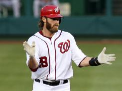 Washington Nationals right fielder Jayson Werth claps his hands after getting a hit in his return from injury against the Philadelphia Phillies.