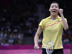 London, United Kingdom; Michele Li (CAN) reacts to a earned point against Mizuki Fuji and Reika Kakiiwa (JPN) in the women's double semifinals during the London 2012 Olympic Games at Wembley Arena.