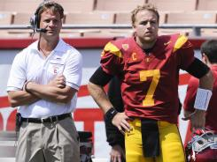 Helped by the return of quarterback Matt Barkley, right, USC coach Lane Kiffin has the Trojans in position to contend for a national title.