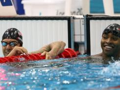 The USA's Anthony Ervin, left, and Cullen Jones look at the scoreboard after competing in the 50-meter freestyle semifinals.