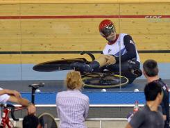 Philip Hindes and his British teammates got a restart after his crash, earning the gold medal in the men's team sprint.