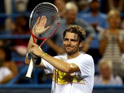 Mardy Fish acknowledges the crowd after his win over Ricardas Berankis of Lithuania Thursday at the Citi Open.
