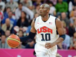 The USA's Kobe Bryant, dribbling against Nigeria on Thursday, has called the idea of using 23-and-under players for the Olympics &quot;stupid.&quot;
