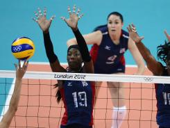 Destinee Hooker (19) rises for a block during the USA's victory against Serbia.