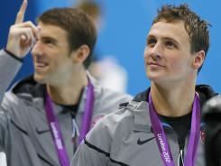 U.S. swimmer Ryan Lochte, right, with Michael Phelps, celebrated his 28th birthday on Friday, as well as the end of his competition in London.