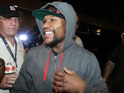 Floyd Mayweather Jr. smiles after exiting the Clark County Detention Center after serving two months of a three-month sentence.