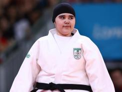 Wojdan Shaherkani's time in the judo competition lasted just 82 seconds, but she left a lasting impression as the first woman to compete in an Olympics for Saudi Arabia.
