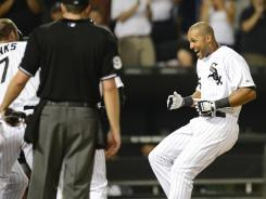 Alex Rios is greeted by his White Sox teammates after hitting a two-run winning homer against the Angels on Friday night.