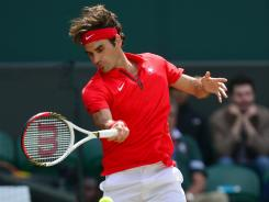 Roger Federer of Switzerland lines up a forehand during his victory Friday against Argentina's Juan Martin del Potro in the Olympic semifinals at Wimbledon.