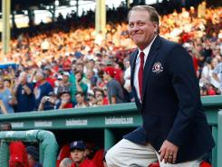 Former pitcher Curt Schilling is introduced Friday before being inducted into the Red Sox Hall of Fame at Fenway Park.