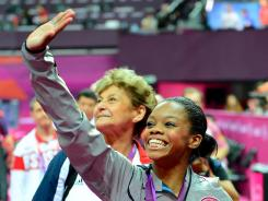 Gabby Douglas waves to the crowd after her gold medal-winning performance Thursday.