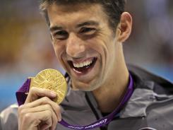When it comes to ratings gold for NBC, there's nothing like U.S. swimmer Michael Phelps, who won another one Friday in the 100-meter butterfly.