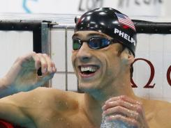 Michael Phelps celebrates after wining the men's 100m butterfly final.