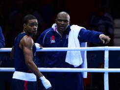 U.S. boxing coach Derrick James, right, reacts after Errol Spence lost to Krishan Vikas. The decision was overturned hours after the match.