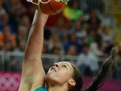 Australian center Liz Cambage became the first woman to dunk in Olympic competition during a preliminary-round game against Russia.