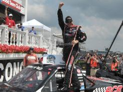 Joey Coulter celebrates after winning the Pocono Mountains 125 Camping World Truck Series race Saturday for his first career NASCAR win.