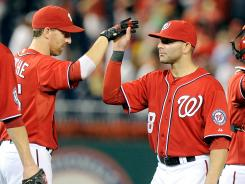 Adam LaRoche, left, and Danny Espinosa, right, of the Washington Nationals celebrate after a victory against the Miami Marlins at Nationals Park.