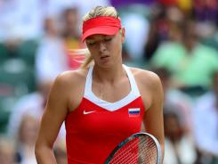 Maria Sharapova of Russia shows her frustration during her 6-0, 6-1 loss Saturday to Serena Williams in the gold medal match at the Olympics.