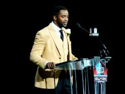 Curtis Martin speaks at the 2012 Pro Football Hall of Fame enshrinement Saturday at Fawcett Stadium.