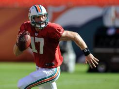 Ryan Tannehill scrambles during a scrimmage at Sun Life Stadium. The rookie unofficially threw for 114 yards and a touchdown.