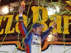 Elliott Sadler celebrates after winning the U.S. Cellular 250 for his fourth Nationwide Series win of the year and his second in three weeks.
