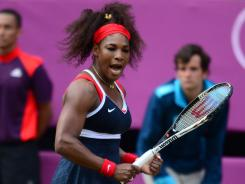 Serena Williams celebrates a point against Maria Sharapova on her way to her first Olympic singles gold medal on Saturday at Wimbledon.