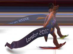 The photo provided by Omega shows the photo finish of the women's triathlon with Switzerland's Nicola Spirig, top, winning gold and Sweden's Lisa Norden, bottom, winning silver at the London Olympics.