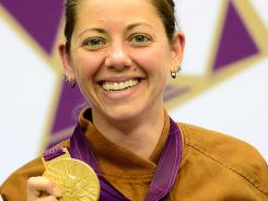 U.S. shooter Jamie Lynn Gray celebrates with her gold medal in the 50-meter rifle three-position.