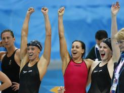 U.S. swimmer Dana Vollmer, left, Rebecca Soni, center, and Missy Franklin, right, celebrate as they win the gold medal, setting a world record of 3:52.05 in the women's 4x100-meter medley relay in the London Olympics.