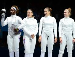 The women's epee team of (from left to right) Maya Lawrence, Courtney Hurley, Kelley Hurley and Susie Scanlan won the USA's first gold in fencing at the London Games.