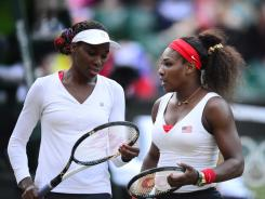 Venus Williams, left, and sister Serena haven't dropped a set en route to the women's doubles final. The sisters will play for their third gold medal Sunday.